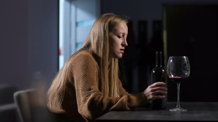 cheated : Crying lonely woman in depression drinking wine
