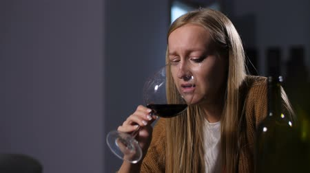 cheated : Abandoned woman in tears drinking alcohol at home Stock Footage