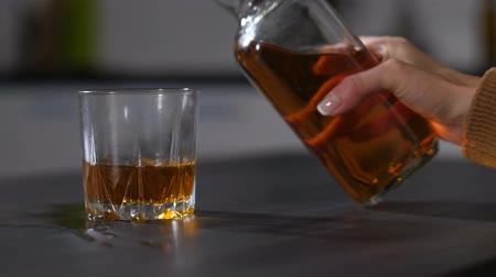 wasted : Female boozers hand pouring alcohol into glass Stock Footage