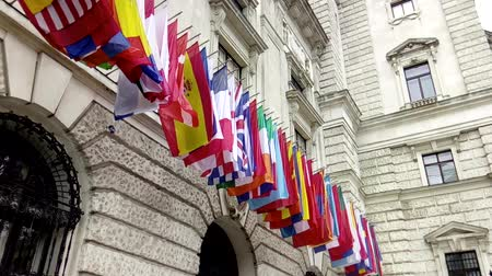 união : ,International flags from OSCE and several nations waving in the wind in front of a historical building Stock Footage