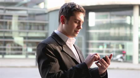 business man : Manager in the city using app on smartphone for finding orientation Stock Footage