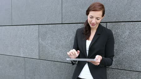 outside : Attractive business woman using tablet computer in the city Stock Footage