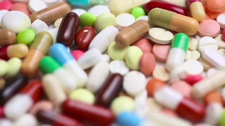 pharmaceuticals : Pharmaceutical pills and colorful medication turning slowly