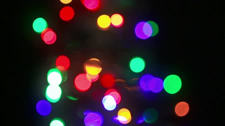 свечение : Christmas treee turning with blinking colorful lights on a black background
