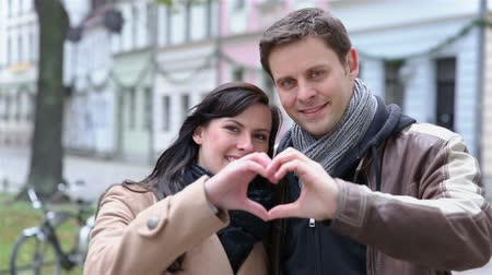 valentin nap : Happy couple holding heart with their hands and moving towards the camera (Full HD)