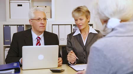 bank : Communication with elderly female customer at office meeting in a bank (Full HD)