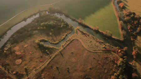 dava : Aerial tracking shot of autumn landscape with river and surrounding countryside Stok Video