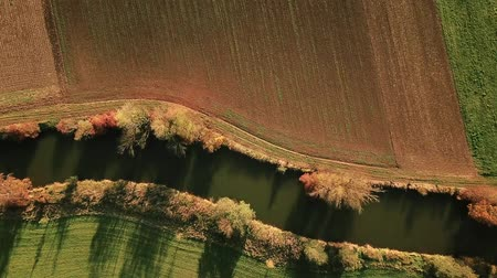 case : Descending aerial tracking shot in German countryside during autumn