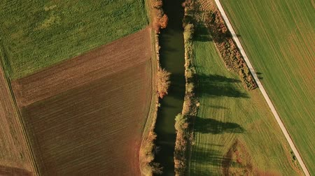 polního : Aerial tracking shot on river through autumn landscape in Germany