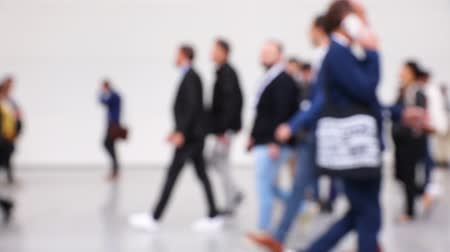 lobby : Blurred crowd of business people walking around a corridor at a trade fair (HD)