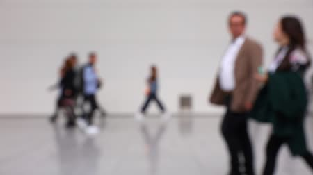 trade show : Blurred crowd of people walking in a hallway at a trade convention or business conference (HD) Stock Footage