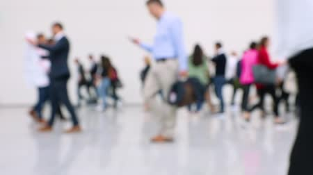 trade show : Blurred crowd of people passing by at a business conference in a hallway (HD)