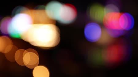Many colorful blurry defocused lights at a fun fair at night (HD)