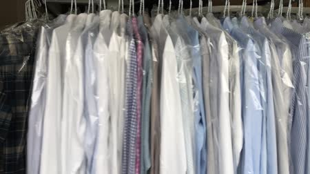 Clean business clothes on dry-cleaning laundry (Full HD) Стоковые видеозаписи