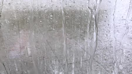 Many raindrops moving on window at rainy weather (Full HD)
