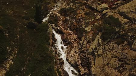 Aerial tracking shot of mountain stream running through rocks in Rh?ne-Alpes region of France (HD) Stockvideo