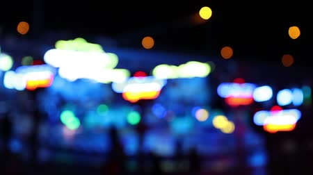 Defocused blinking lights of a carousel ride at night before it starts (HD)