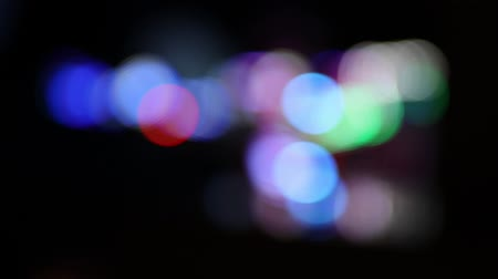 Defocused blinking lights of a moving carousel at carnival ride at night (HD)