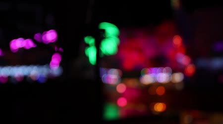 View of blurry lights at a carnival scene with lights at night Stockvideo
