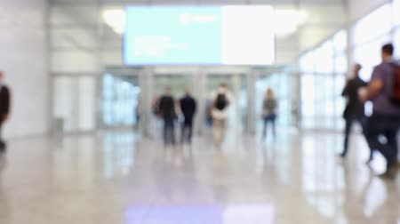 trade show : Blurred conference hall hall with display and people passing through during convention (HD)