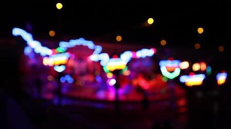 карусель : Carousel ride at night with a colorful defocused lights (HD)
