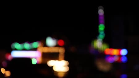 carnival ride : Defocused shot of illuminated carnival lights at night with many blinking lights (HD)