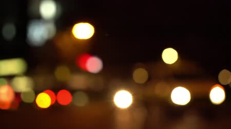 berlin skyline : Defocused pan shot of a busy intersection in Berlin at night with traffic passing through in various directions (HD) Stock Footage