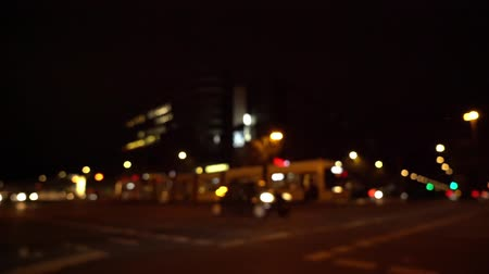 berlin skyline : Defocused view of busy intersection at night with street car and bus passing by (HD) Stock Footage