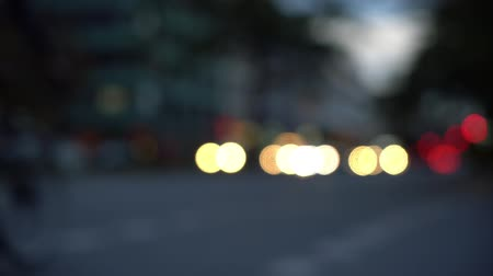 many lights : Blurry bokeh view of Berlin street at night with vehicles passing through and through shot (HD)