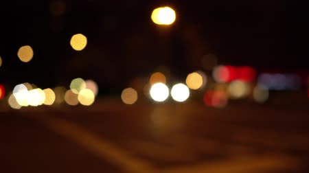 berlin skyline : Defocused view of oncoming traffic on a busy intersection at night in Berlin (HD) Stock Footage