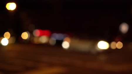 many lights : Blurry view of oncoming city traffic passing by on a busy intersection at night in Berlin (HD) Stock Footage
