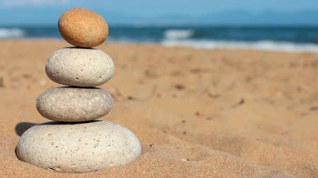 zen como : Imbalance. Summer. Wild beach. someones hand brakes equilibrium