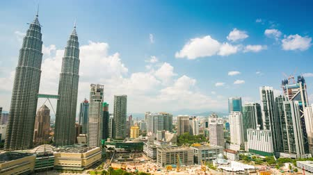 conference centre : KUALA LUMPUR, MALAYSIA - CIRCA FEB 2014: 4K timelapse, cloudscape view of the Petronas Twin Towers and Kuala Lumpur City Center. Super high quality, 4k resolution (4096x2304).