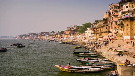 varanasi : VARANASI, INDIA - CIRCA MAY 2014: 4k timelapse, view of Ganges river with the boats and holy ghats. Varanasi is one of the oldest continuously inhabited cities in the world and the oldest in India.  Stock Footage