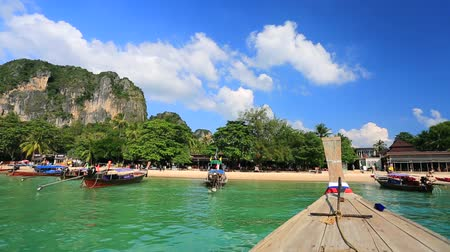 keleti : Moving to the Railay beach on thai traditional wooden boat. Krabi, Thailand.