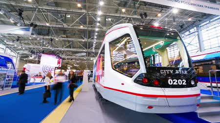 общественный : MOSCOW, RUSSIA - CIRCA NOVEMBER, 2014: People visit ExpoCityTrans exhibition. ExpoCityTrans is a unique event in the sphere of public transport consisting of an exhibition and business events.