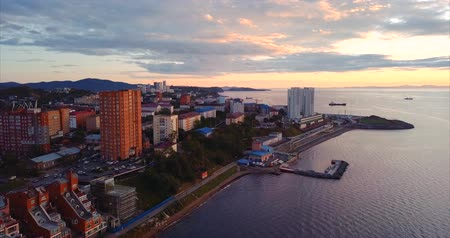 элита : Aerial view of Vladivostok city center, Egersheld peninsula. Russia. Residential district. The Golden Horn Bay (sea of ??Japan) is on the right. Beautiful autumn sunset