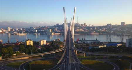 dia : Great aerial view of the Golden Bridge (built in 2012) and junction with driving cars. Its a cable-stayed bridge across the Zolotoy Rog harbor. Vladivostok, Russia. Sunny autumn day