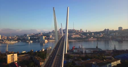 dia : Impressive aerial view of the Golden Bridge (built in 2012) and junction with driving cars. Its a cable-stayed bridge across the Zolotoy Rog harbor. Vladivostok, Russia. Sunny autumn day