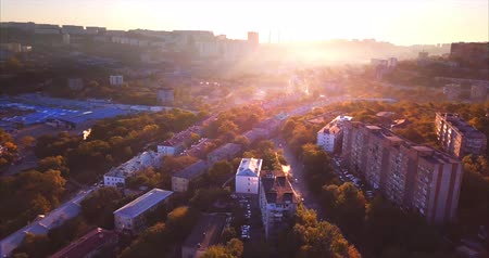 cars traffic : VLADIVOSTOK, RUSSIA-SEPTEMBER 25, 2017: Flying backwards, aerial view of Vladivostok at sunrise and Mazda vehicles (Mazda vehicles, Russia)