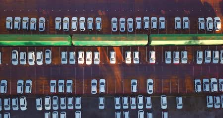 auto parking : Aerial top zooming out view of new cars. Vladivostok, Mazda Sollers joint venture parking, Russia Stock Footage