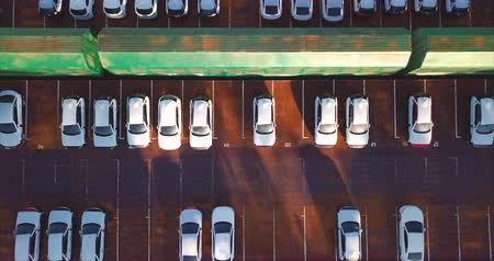 Aerial top zooming in view of new cars. Vladivostok, Mazda Sollers joint venture parking, Russia Vídeos