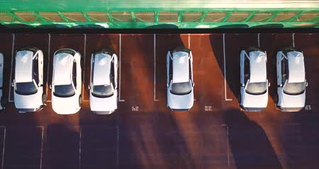 Aerial top zooming in and out of view. Vladivostok, Mazda Sollers joint venture parking, Russia Vídeos