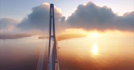 Breathtaking aerial view of the cable-stayed Russian bridge across the Eastern Bosphorus strait on the way to Russian island in Vladivostok, Russia. Morning, sunrise Vídeos