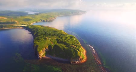 Amazing aerial view of Vyatlina cape situated on the South-East part of the green island. Russia, Vladivostok. Morning