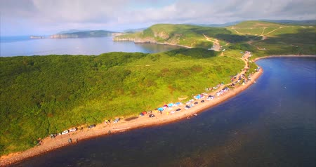 Aerial zooming out of the car. Vyatlina cape, situated on the South-East part of the green island. Russia, Vladivostok