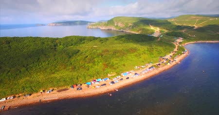 Aerial view of the coast full of tourists cars and camps. Vyatlina cape, situated on the South-East part of the green island. Russia, Vladivostok