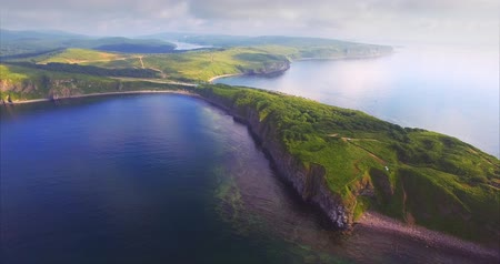 Breathtaking aerial view of Vyatlina cape situated on the South-East part of the green island. Russia, Vladivostok. Morning