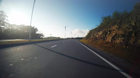 View from the car: driving along the empty road in Russian island. Vladivostok, Russia. Sunny morning