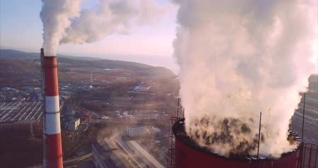 Close view of Central Heating and Power Plant. Two more chimneys are on the background. Vladivostok, Russia. Sunrise. Aerial Vídeos